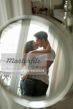 Couple kissing in mirror Stock Photo - Premium Royalty-Free, Image code: 649-06532538