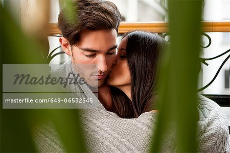 Kissing couple wrapped in blanket Stock Photo - Premium Royalty-Free, Image code: 649-06532545