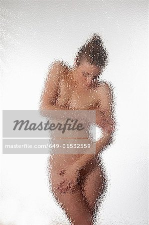 Woman covering herself in shower Stock Photo - Premium Royalty-Free, Image code: 649-06532559
