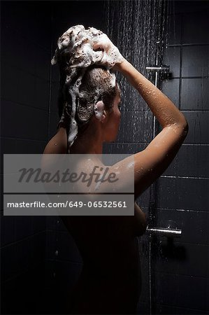 Woman washing hair in shower Stock Photo - Premium Royalty-Free, Image code: 649-06532561