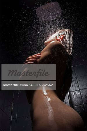 Woman washing hair in shower Stock Photo - Premium Royalty-Free, Image code: 649-06532562
