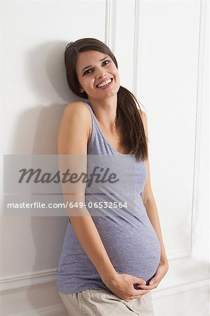 Pregnant woman holding belly Stock Photo - Premium Royalty-Free, Image code: 649-06532564