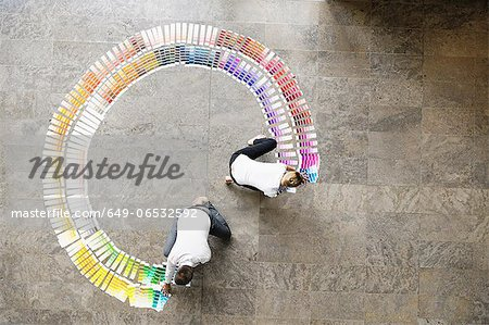 Business people examining paint swatches Stock Photo - Premium Royalty-Free, Image code: 649-06532592