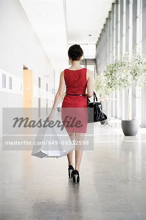 Businesswoman walking in lobby Stock Photo - Premium Royalty-Free, Image code: 649-06532598
