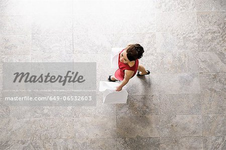 Overhead view of businesswoman walking Stock Photo - Premium Royalty-Free, Image code: 649-06532603