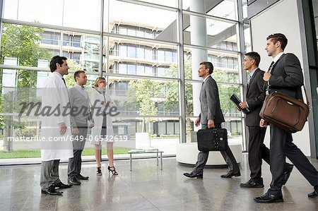 Doctors and businessmen meeting Stock Photo - Premium Royalty-Free, Image code: 649-06532619