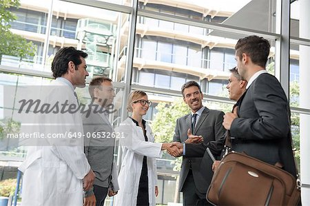 Doctors and businessmen meeting Stock Photo - Premium Royalty-Free, Image code: 649-06532621