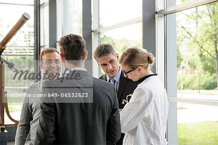Doctor and businessmen talking Stock Photo - Premium Royalty-Free, Image code: 649-06532623