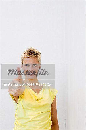 Smiling woman giving 'thumbs up Stock Photo - Premium Royalty-Free, Image code: 649-06532717