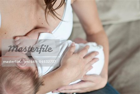 Mother nursing infant son Stock Photo - Premium Royalty-Free, Image code: 649-06532737