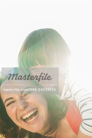 Mother and daughter hugging outdoors Stock Photo - Premium Royalty-Free, Image code: 649-06533026
