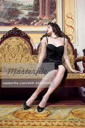 Woman in lingerie on ornate couch Stock Photo - Premium Royalty-Free, Image code: 649-06533245
