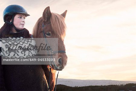 Woman smiling with horse outdoors Stock Photo - Premium Royalty-Free, Image code: 649-06533303