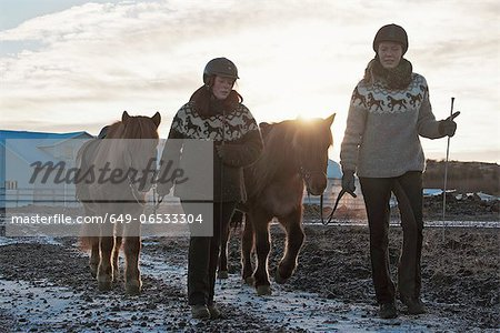 Women walking with horses outdoors Stock Photo - Premium Royalty-Free, Image code: 649-06533304