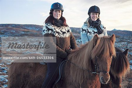 Women riding horses outdoors Stock Photo - Premium Royalty-Free, Image code: 649-06533306
