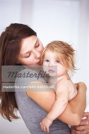 Close up of mother holding daughter Stock Photo - Premium Royalty-Free, Image code: 649-06533365