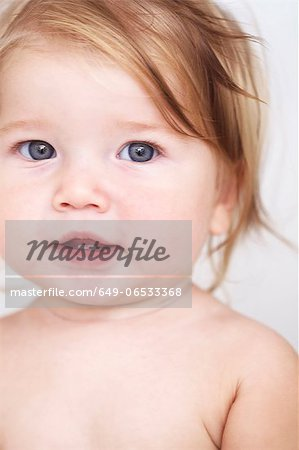 Close up of baby girls smiling face Stock Photo - Premium Royalty-Free, Image code: 649-06533368