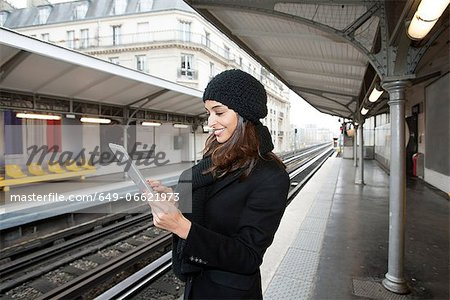 Woman using tablet computer on platform Stock Photo - Premium Royalty-Free, Image code: 649-06621973