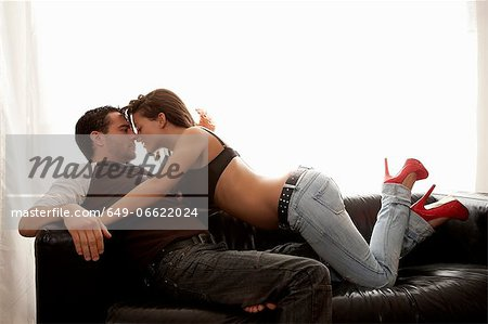 Semi nude woman kissing boyfriend Stock Photo - Premium Royalty-Free, Image code: 649-06622024