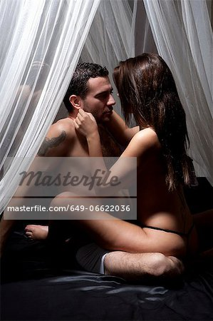 Nude couple kissing on bed Stock Photo - Premium Royalty-Free, Image code: 649-06622036