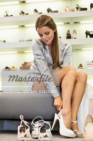 Woman trying on shoes in store Stock Photo - Premium Royalty-Free, Image code: 649-06622181