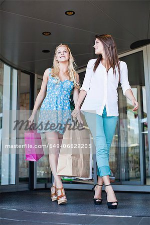 Women shopping together on city street Stock Photo - Premium Royalty-Free, Image code: 649-06622205