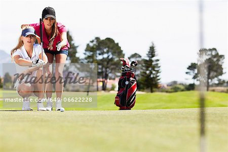 Women playing golf on course Stock Photo - Premium Royalty-Free, Image code: 649-06622228