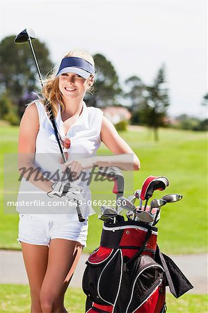 Woman with golf bag on course Stock Photo - Premium Royalty-Free, Image code: 649-06622230