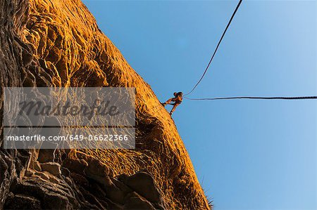 Rock climber scaling steep rock face Stock Photo - Premium Royalty-Free, Image code: 649-06622366
