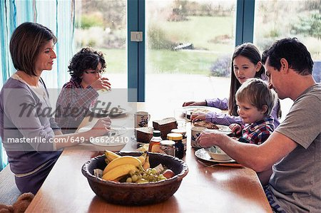 Family having dinner together at table Stock Photo - Premium Royalty-Free, Image code: 649-06622410