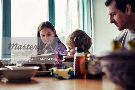 Family eating together at table Stock Photo - Premium Royalty-Free, Image code: 649-06622415