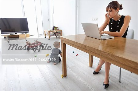 Businesswoman working at home Stock Photo - Premium Royalty-Free, Image code: 649-06622529