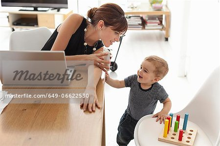 Businesswoman working at home Stock Photo - Premium Royalty-Free, Image code: 649-06622530