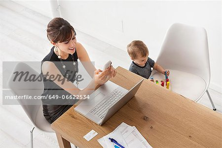Businesswoman working at home Stock Photo - Premium Royalty-Free, Image code: 649-06622534