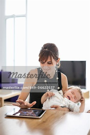 Businesswoman holding crying son Stock Photo - Premium Royalty-Free, Image code: 649-06622537