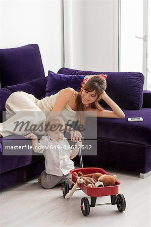 Mother and son relaxing in living room Stock Photo - Premium Royalty-Free, Image code: 649-06622542