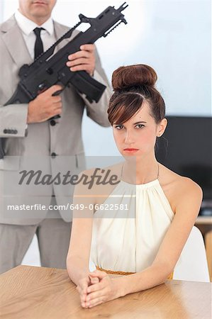 Woman and boyfriend with machine gun Stock Photo - Premium Royalty-Free, Image code: 649-06622581