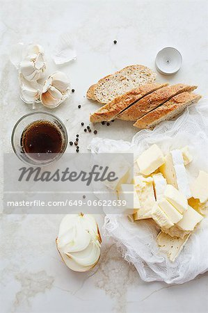 Sliced bread, butter and garlic Stock Photo - Premium Royalty-Free, Image code: 649-06622639