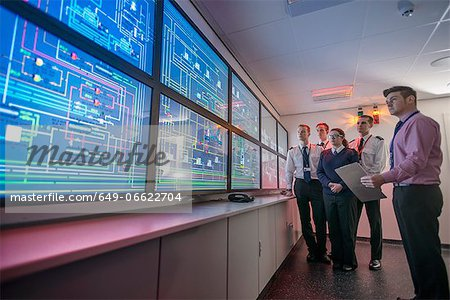 Personnel working in ships engine room Stock Photo - Premium Royalty-Free, Image code: 649-06622704