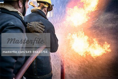 Firefighters in simulation training Stock Photo - Premium Royalty-Free, Image code: 649-06622756