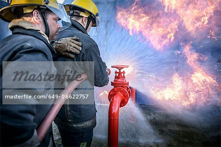 Firefighters in simulation training Stock Photo - Premium Royalty-Free, Image code: 649-06622757