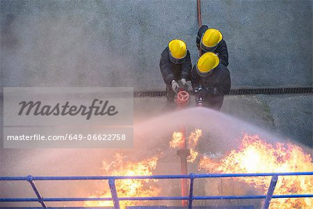 Firefighters in simulation training Stock Photo - Premium Royalty-Free, Image code: 649-06622758