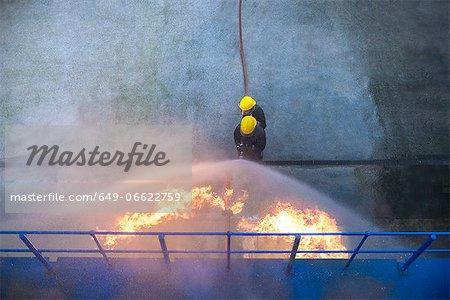 Firefighters in simulation training Stock Photo - Premium Royalty-Free, Image code: 649-06622759