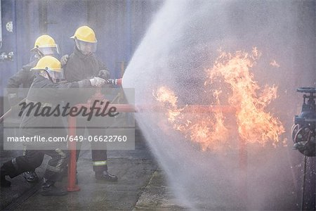 Firefighters in simulation training Stock Photo - Premium Royalty-Free, Image code: 649-06622760