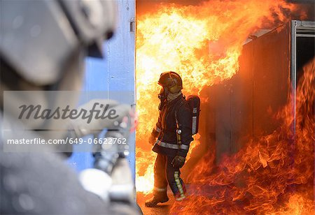 Firefighters in simulation training Stock Photo - Premium Royalty-Free, Image code: 649-06622762