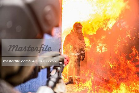Firefighters in simulation training Stock Photo - Premium Royalty-Free, Image code: 649-06622763