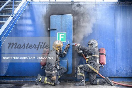 Firefighters in simulation training Stock Photo - Premium Royalty-Free, Image code: 649-06622764