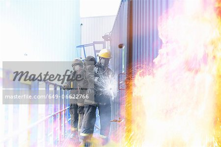 Firefighters in simulation training Stock Photo - Premium Royalty-Free, Image code: 649-06622766