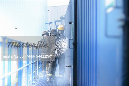 Firefighters in simulation training Stock Photo - Premium Royalty-Free, Image code: 649-06622767