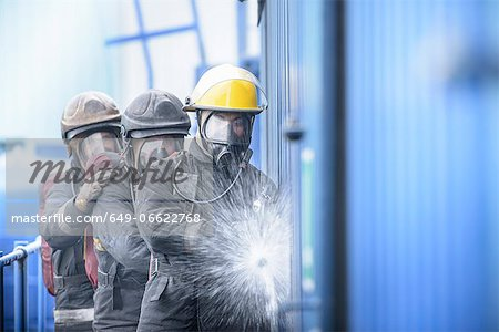 Firefighters in simulation training Stock Photo - Premium Royalty-Free, Image code: 649-06622768